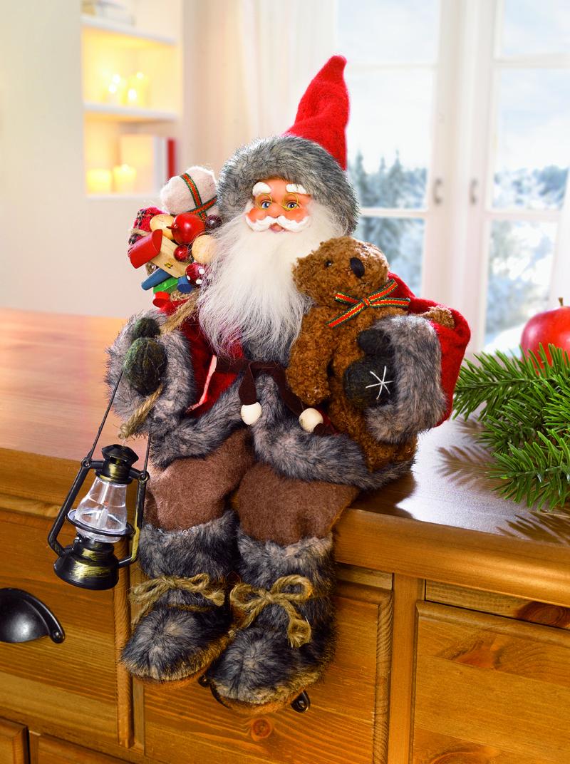 Сидящий Санта Клаус